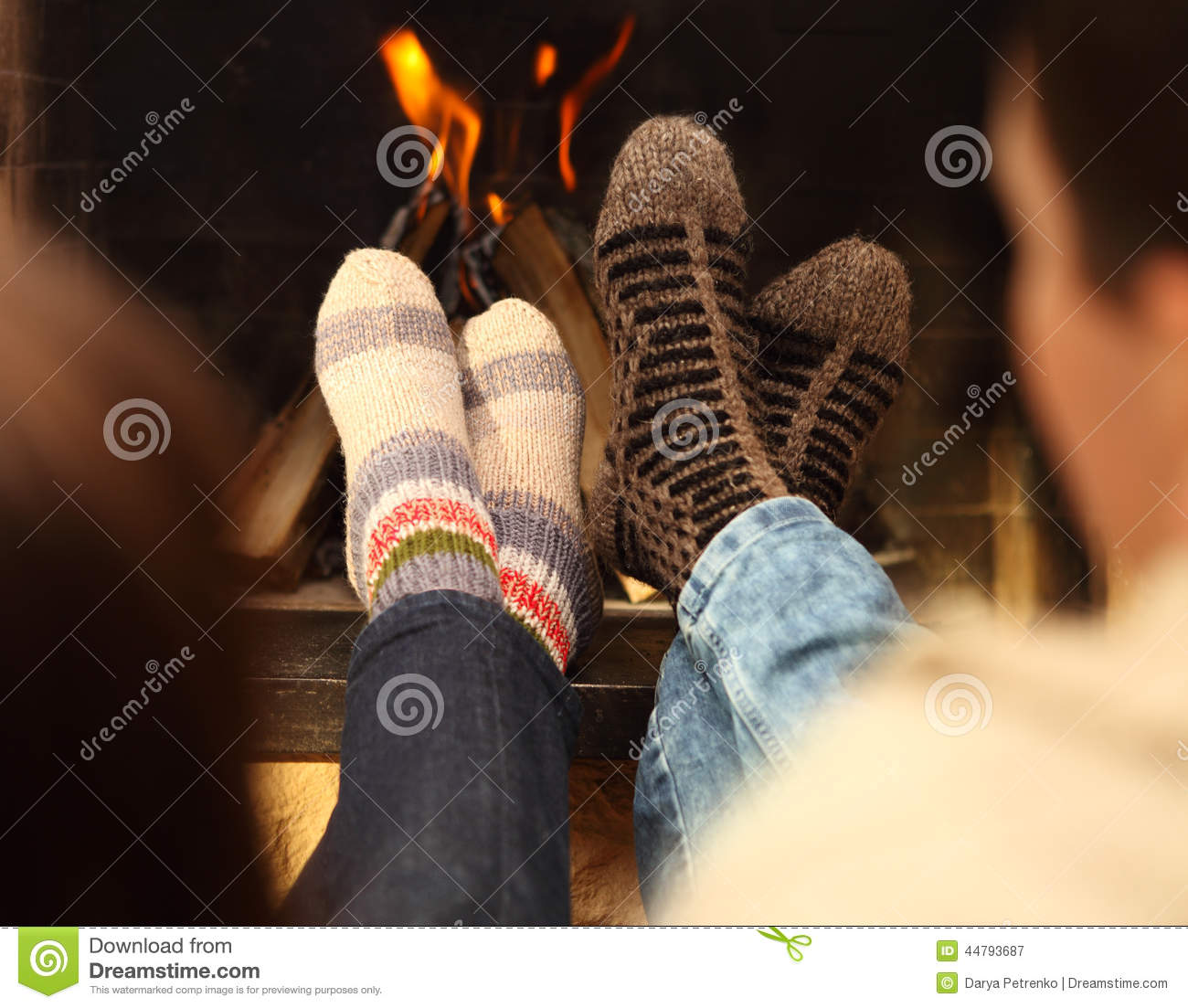 Couple Relaxing In Front Of Fireplace Man Looking At Woman Stock Legs Of A Couple In Socks In Front Of Fireplace At Winter