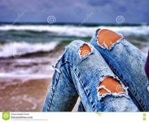 Legs Of Woman Sitting Coast Ocean With Waves. Hot