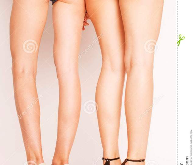 Legs Of Young Women Pair Of Butts In Jeans Shorts Isolated On White