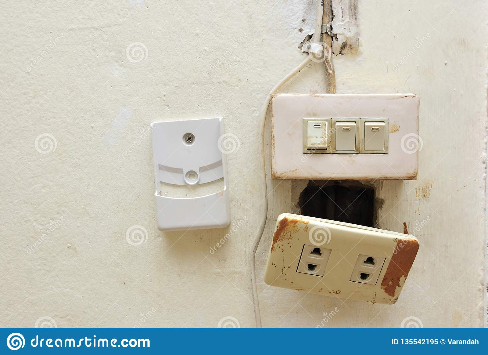 hight resolution of a light switch and electrical breaker with damaged wiring on the wall