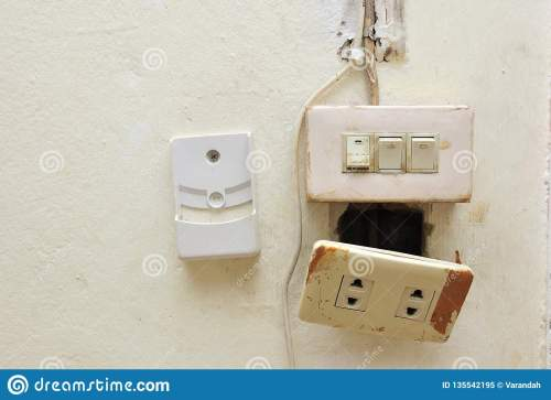 small resolution of a light switch and electrical breaker with damaged wiring on the wall