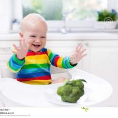 Baby High Chair For Eating Swivel Gumtree Glasgow Little Boy Broccoli In White Kitchen Stock Photo
