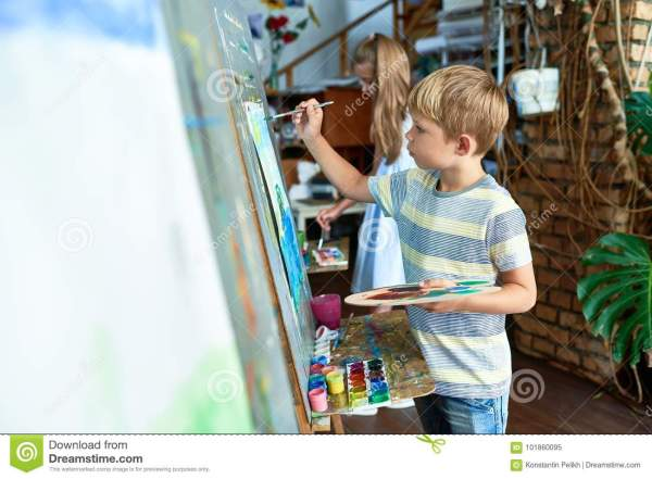 Little Boy Painting In Art Class Stock - Of