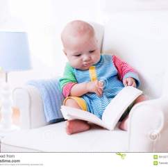 Toddler Reading Chair Indoor Hanging Chairs Uk Little Boy A Book Stock Photo Image 60120731