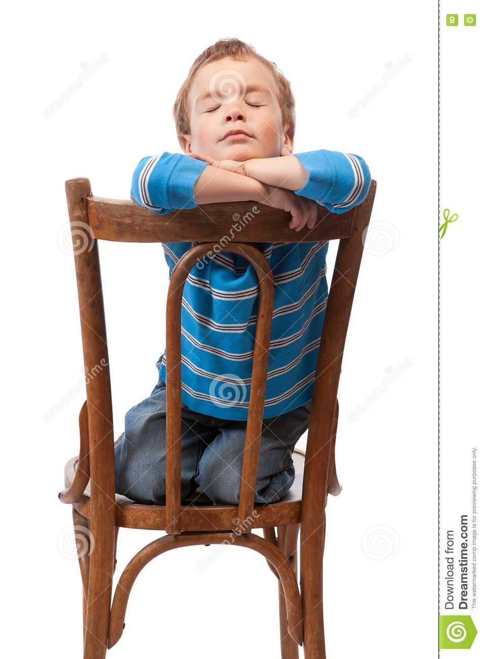 Little Boy Sits In Chair With His Eyes Closed Stock Photos