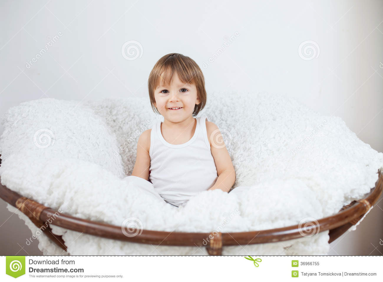 little boy chairs barcelona chair white sitting in a big royalty free stock