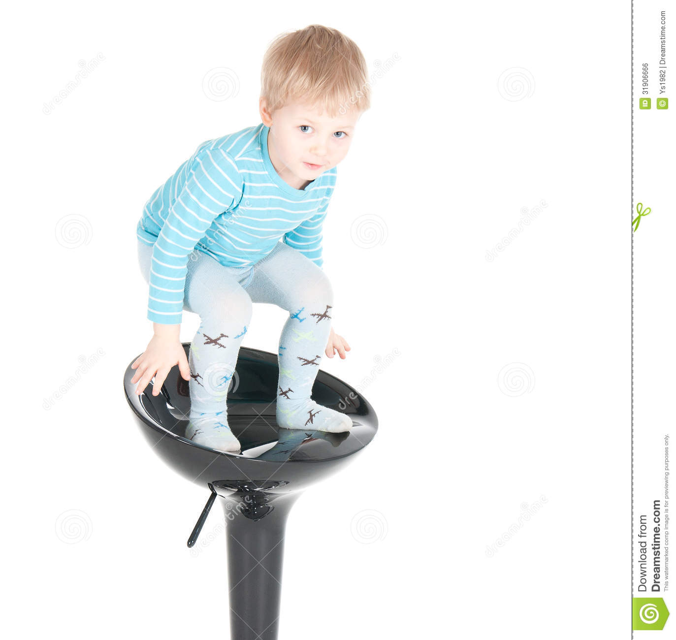 Little Boy Sitting In A Chair Royalty Free Stock Image