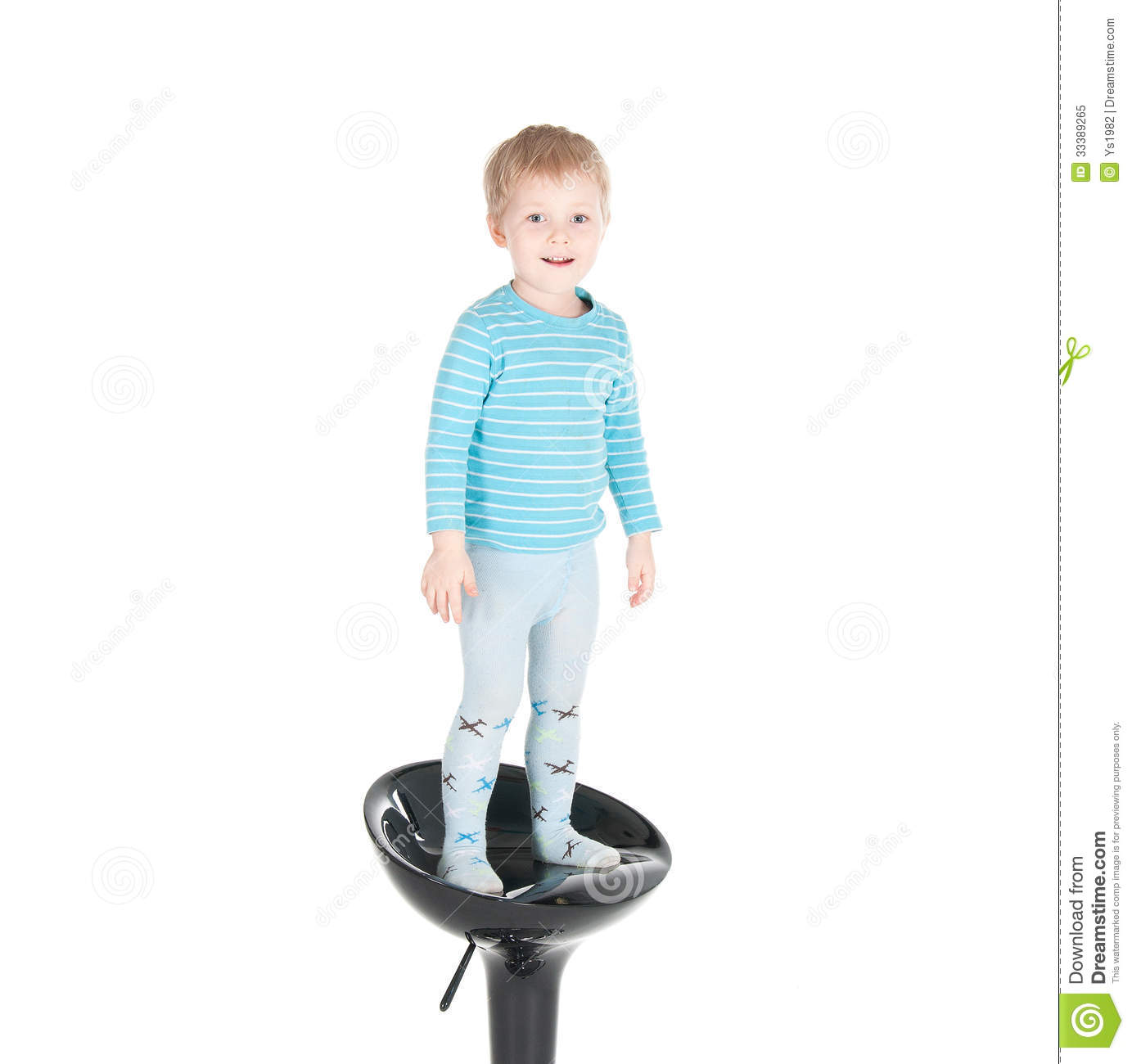 Little Boy Sitting In A Chair Royalty Free Stock Photo