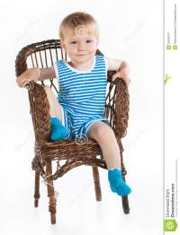 Little Boy Sitting In Wickerwork Chair Stock Image