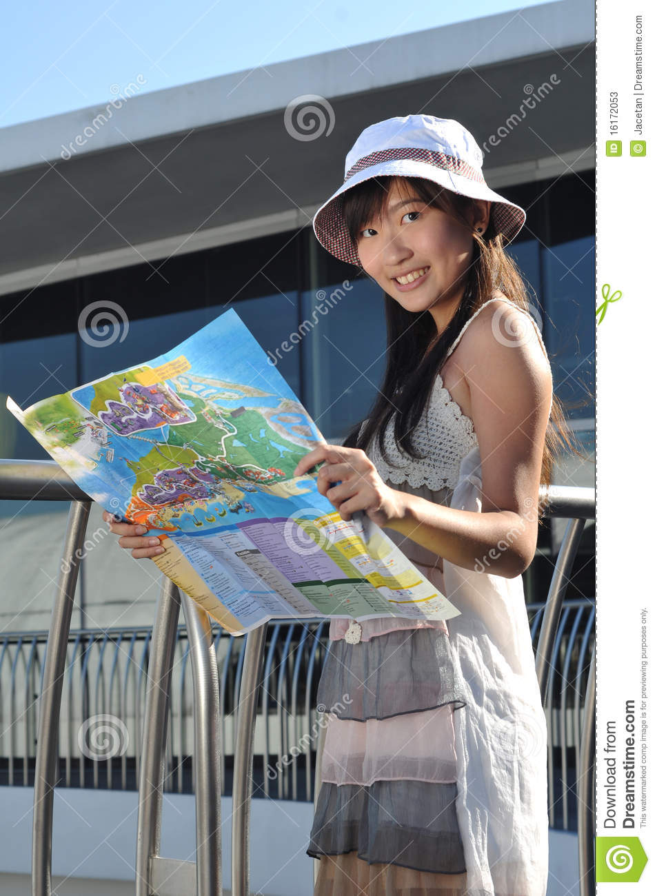 Little Chinese Asian Tourist Girl With Map 2 Stock Photos