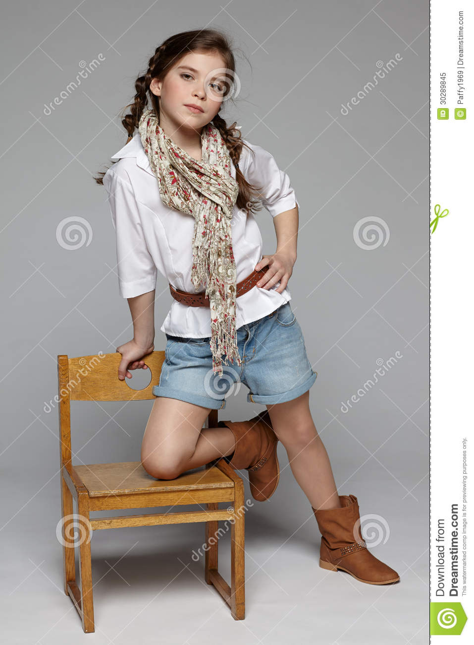 Little Girl Standing Leaning On The Chair Royalty Free