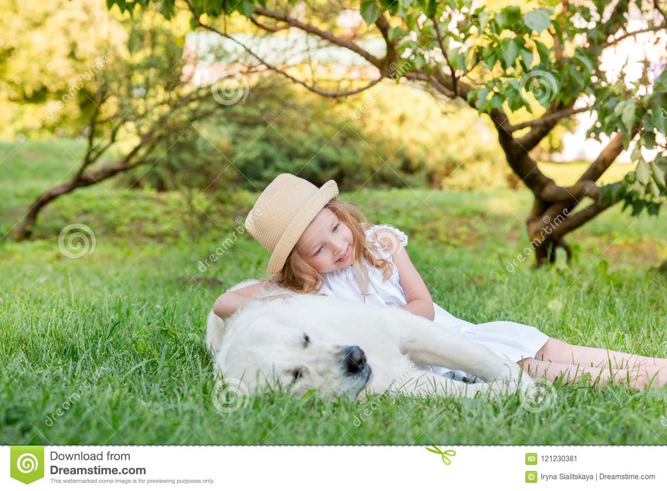 Little Girl With A Big White Dog In The Park A Beautiful 5 Year Old Girl In White Dress Hugs Her Favorite Dog During A Summer Walk