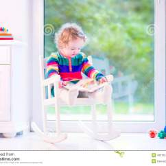 Little Girl Rocking Chair Bariatric Shower With Wheels A Book In Stock Image Of Cute Curly Funny Toddler Wearing Warm Colorful Knitted Dress Reading Relaxing White Next To Big Garden View