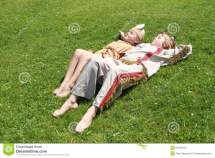 Little Girl And Boy Sleaping Grass Stock