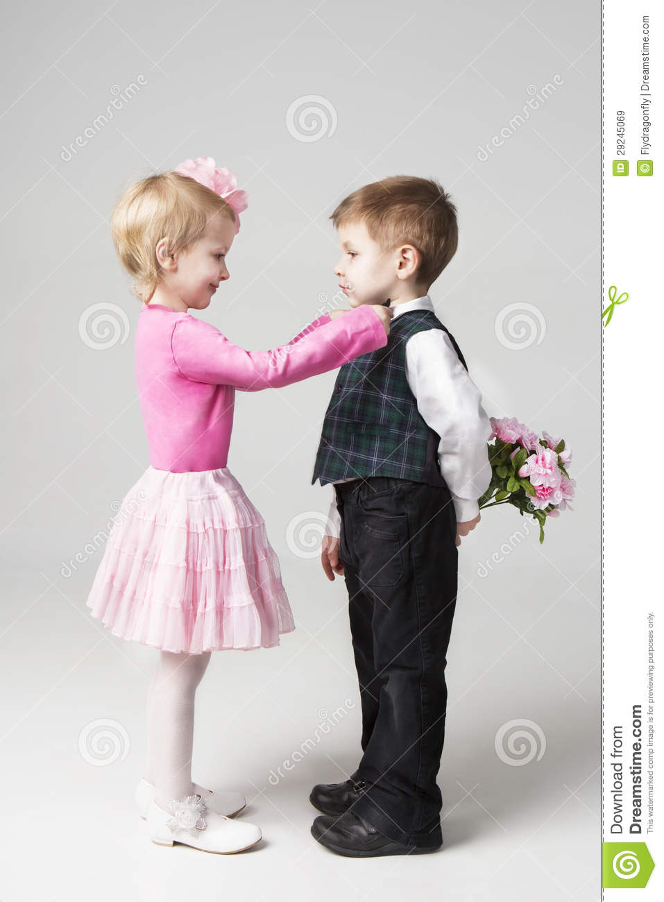 Little Girl Corrects Boys Tie Royalty Free Stock Images