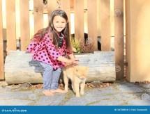 Little Girl Stroking Cat Royalty Free Stock