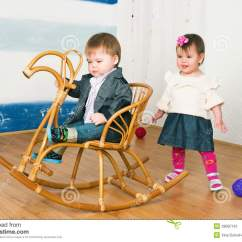 Little Girl Rocking Chair Donati Office On A Horse Stock Image