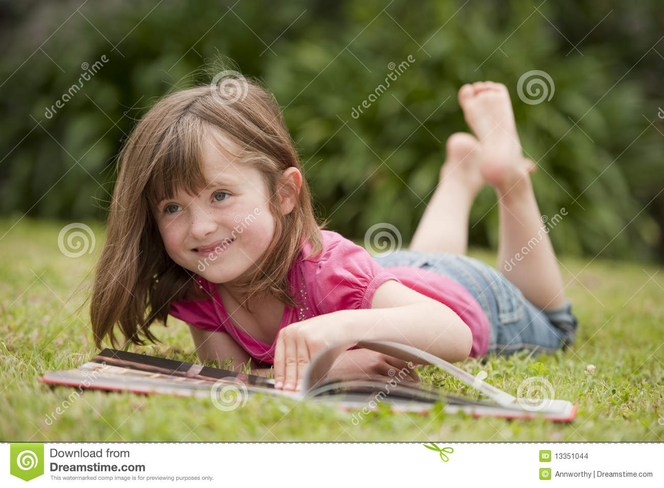 Little Girl Laying In Grass Reading Stock Photo - Image of ...
