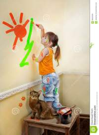 Little Girl Painting Her Room Stock Photo