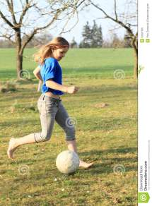 Little Girl Playing Football Barefoot Stock
