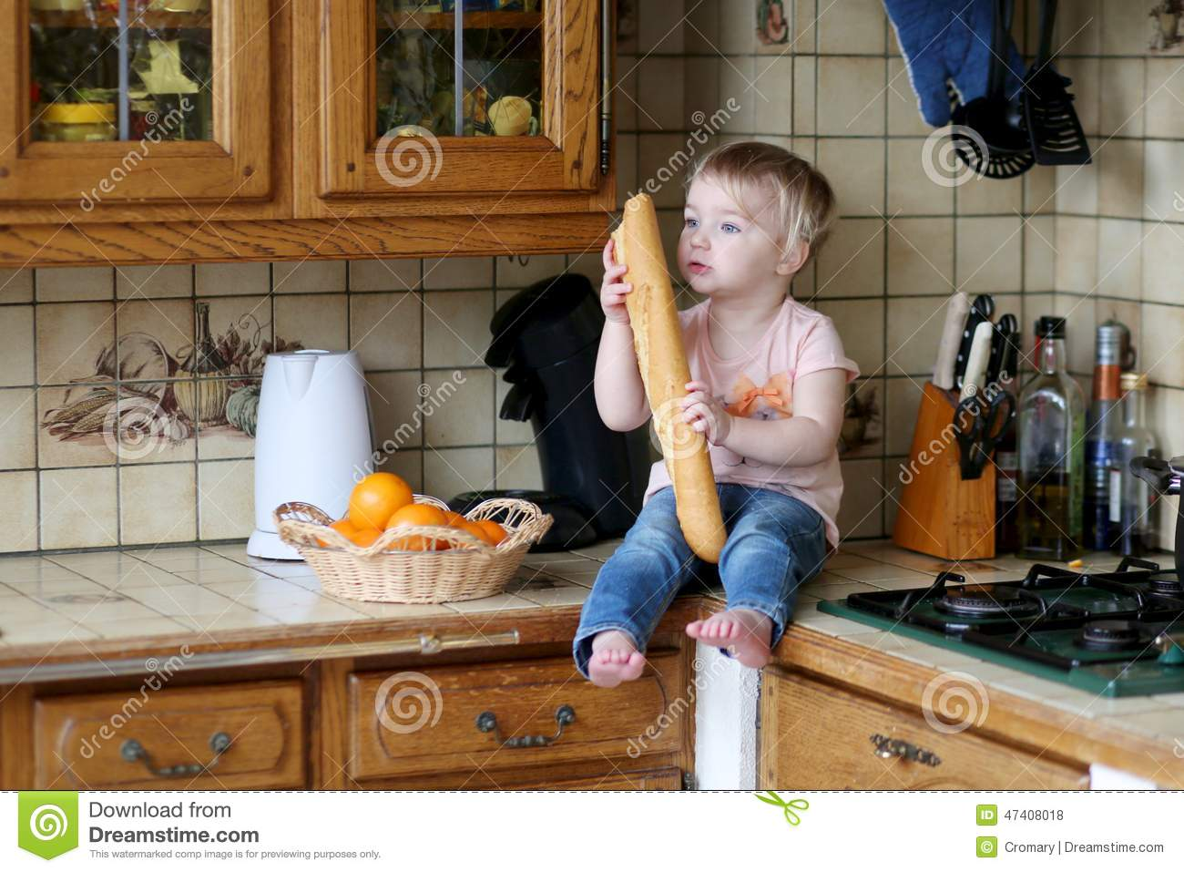 Little Girl Playing In The Kitchen Stock Photo Image
