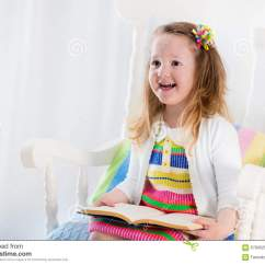 Kids Reading Chair Cross Back Dining Little Girl A Book Stock Photo Image Of People