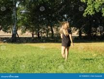Little Girl Running Barefoot Stock - Of Grass