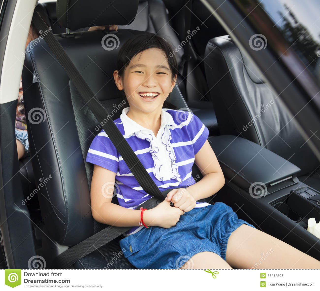 Little Girl Sitting In The Car With Seat Belt Stock Photos