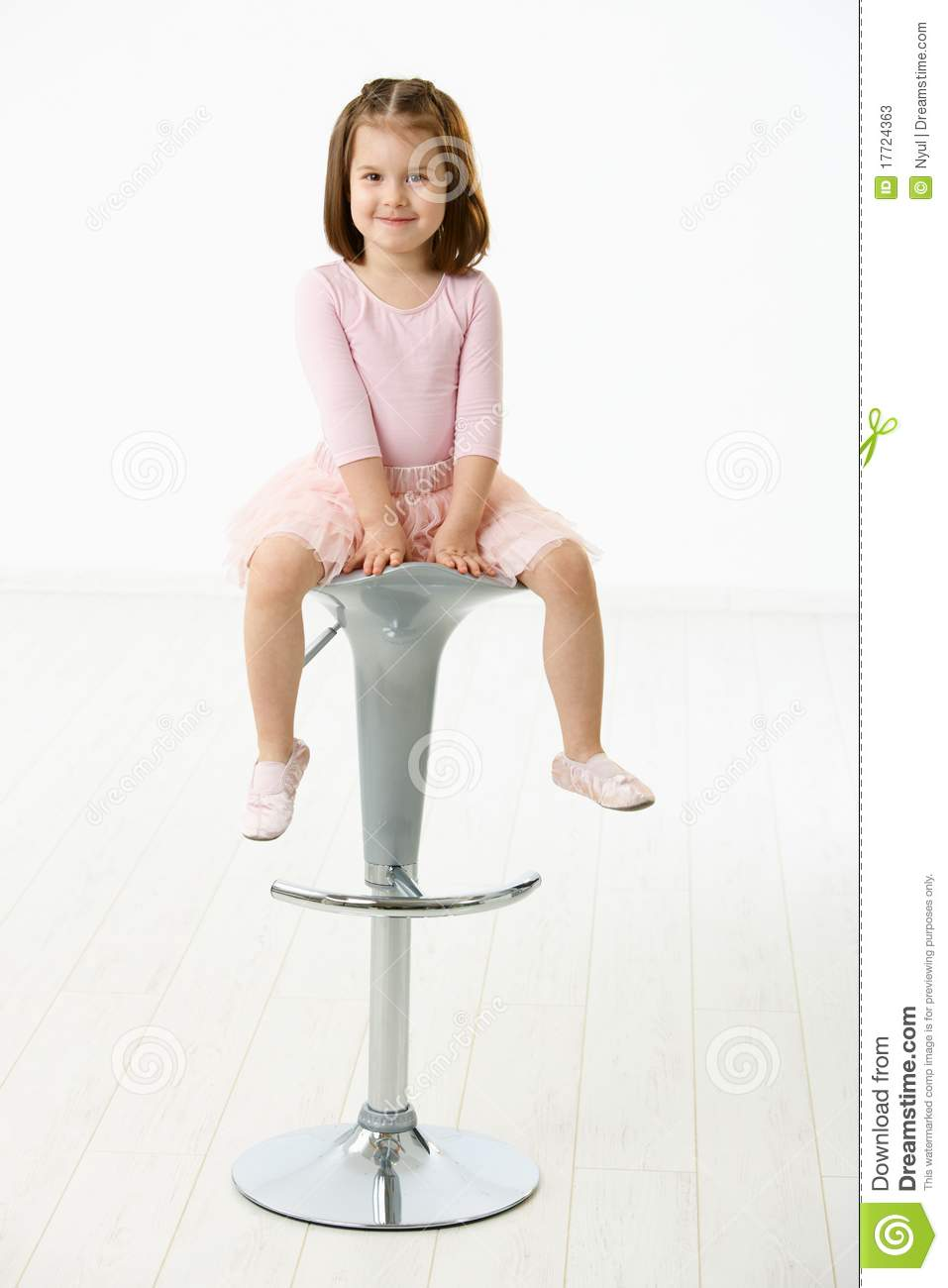 little girl chairs coleman camp with side table sitting on chair stock image of caucasian happy