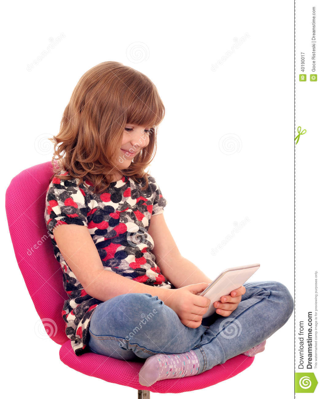 little girl chairs french country kitchen chair pads sitting on and play with tablet pc stock