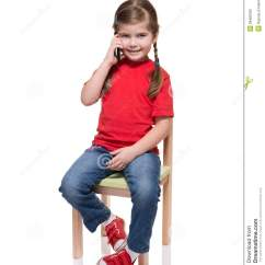 Little Girls Chairs Waterproof Chair Covers Australia Girl Sitting On A And Speaking By Smartphone