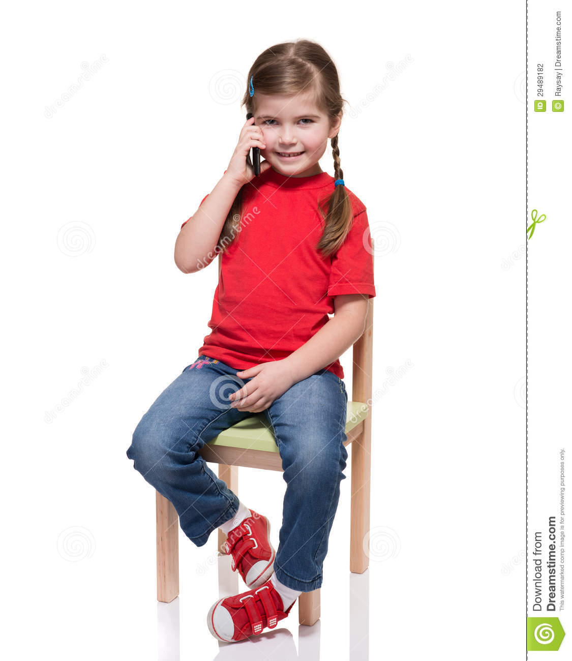 little girl chairs recliner office chair malaysia sitting on a and speaking by smartphone