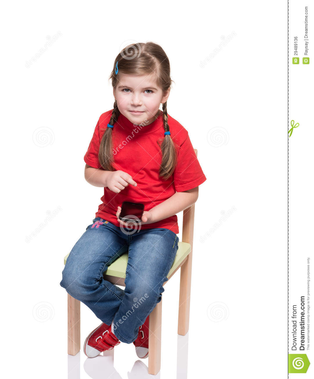 little girl chairs ikea dining chair covers sitting on a and using smartphone stock photo
