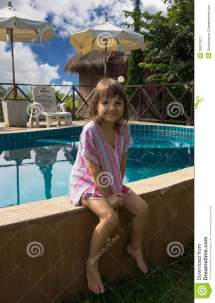 Little Girl Sitting Edge Of Pool Royalty Free Stock