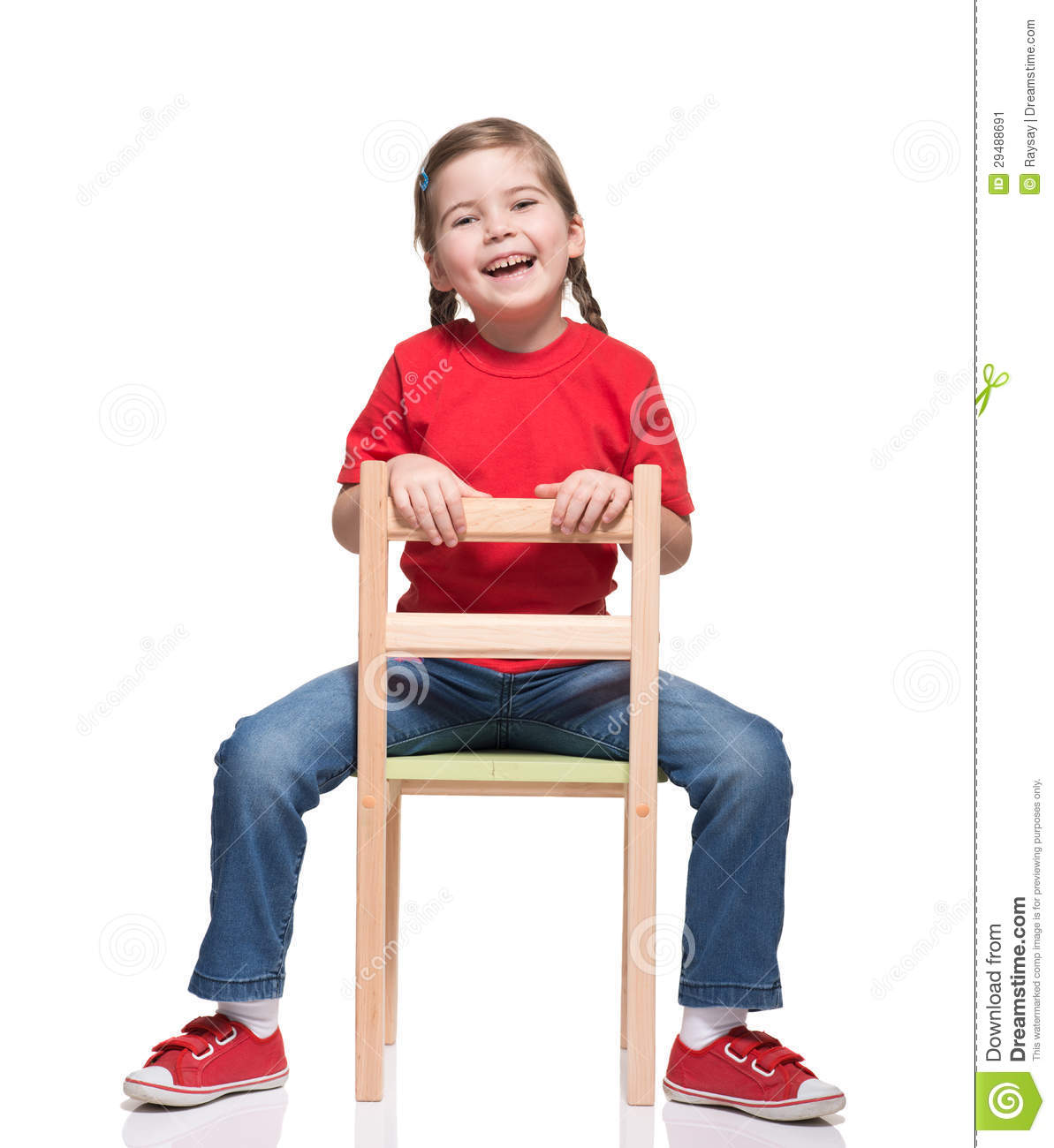 little girl chairs teal club chair wearing red t short and posing on stock