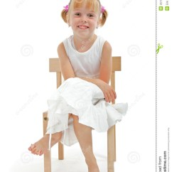 Little Girl Chairs Ez Posture Chair In White Dress Sitting On Wooden Stock Photo And Smile