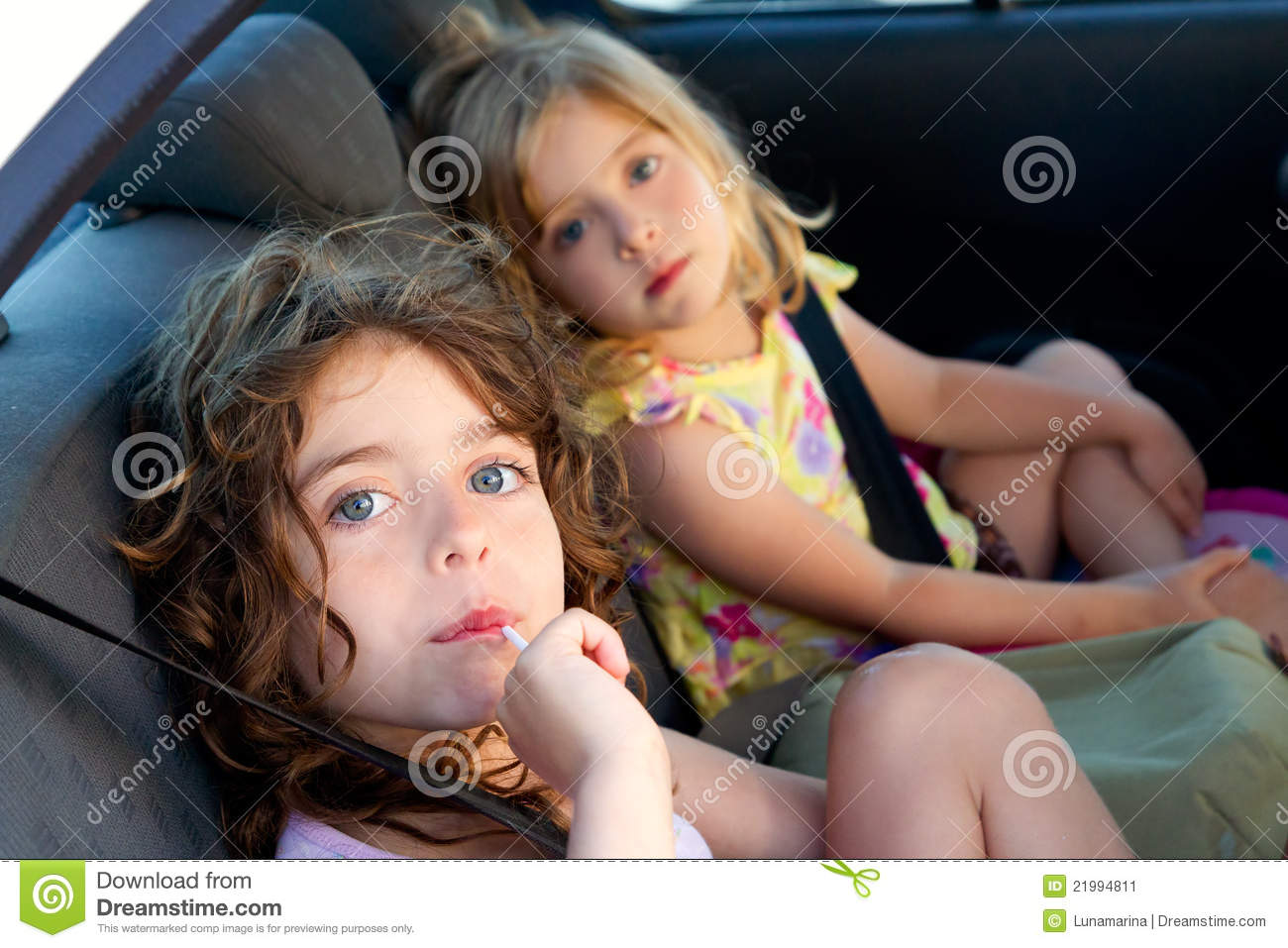 small toddler chair folding hanging rack little girls inside car eating candy stick stock image - image: 21994811