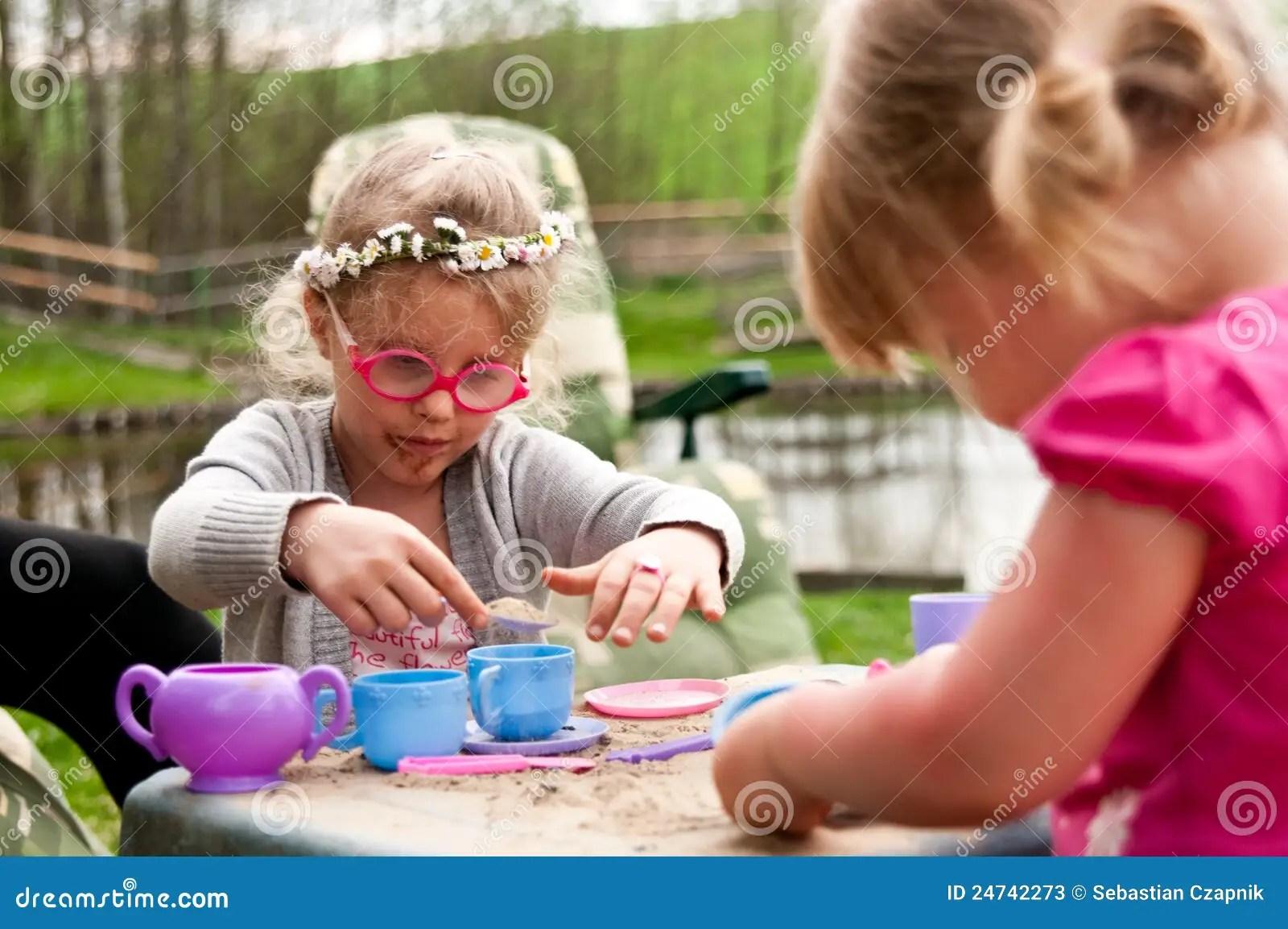 children play kitchen nantucket island little girls playing outdoors stock photos - image: 24742273