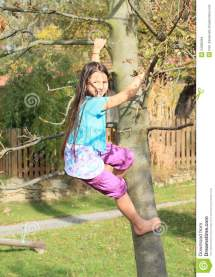 Little Girl Climbing On Tree