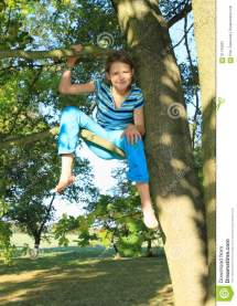 Tree Hanging From a Little Girl Sitting Barefoot