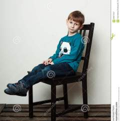 Little Boy Chairs Folding Director With Side Table Back View Of Teenage Sitting On Chair As He Looks Away