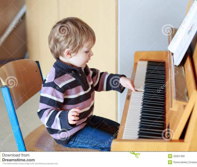 Little Toddler Boy Playing Piano At Music School