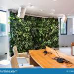 Living Green Wall Vertical Garden Indoors With Flowers And Plants Under Artificial Lighting In Meeting Boardroom Stock Image Image Of Concrete Hydroponic 127695121
