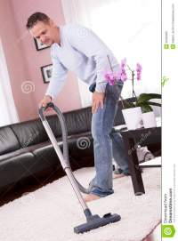 Living Room Cleaning Vacuum Cleaner. Stock Photo
