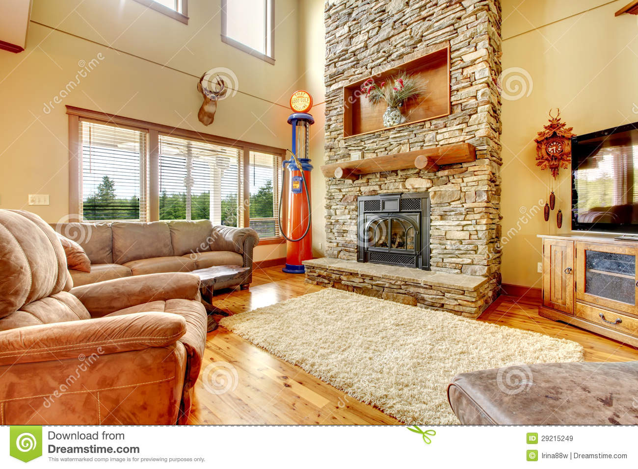brown leather couch living room decor green color palette for with high ceiling, stone fireplace and ...