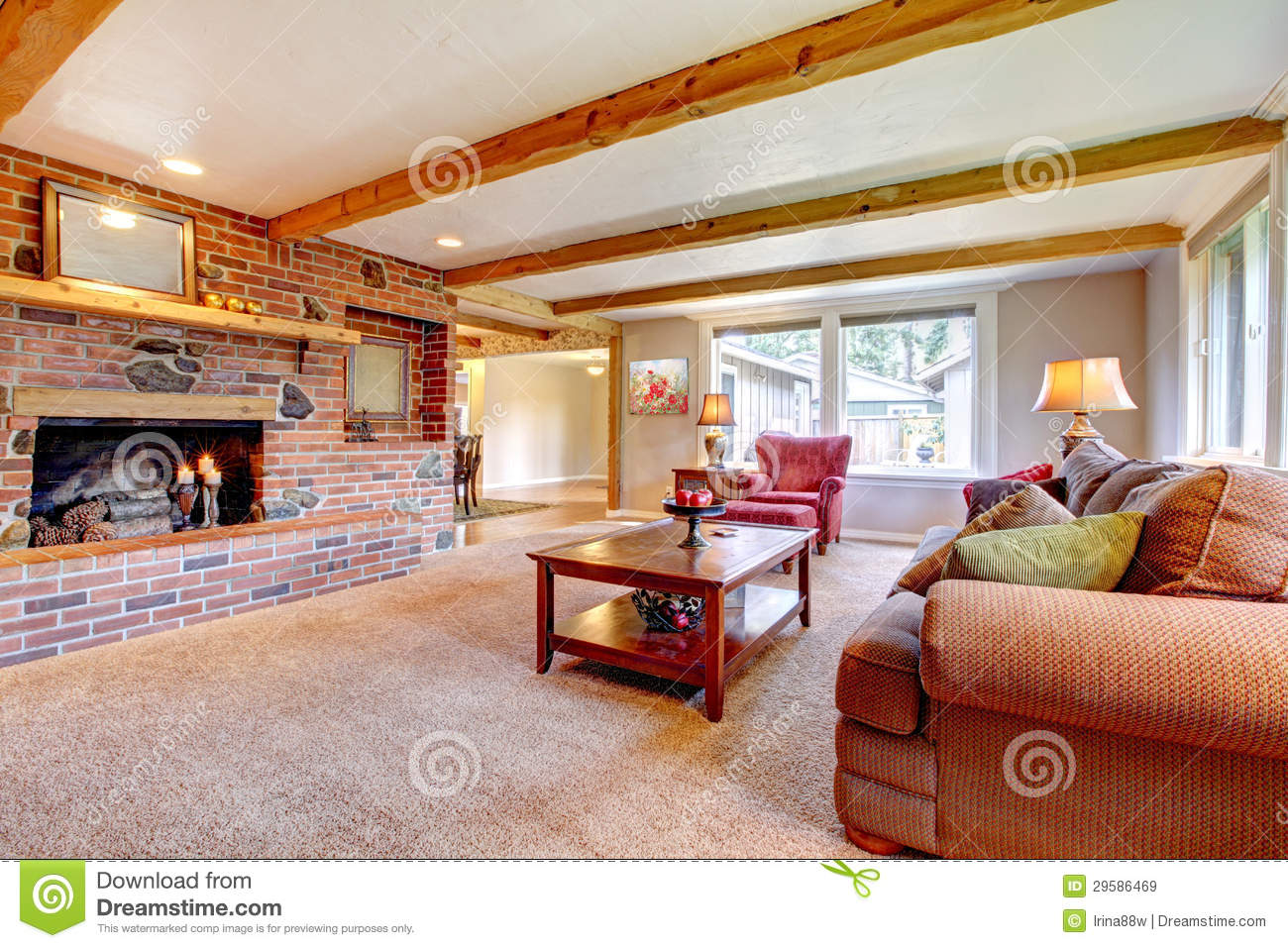 red couch living room photos round table for corner of interior with brick fireplace, wood beams and ...