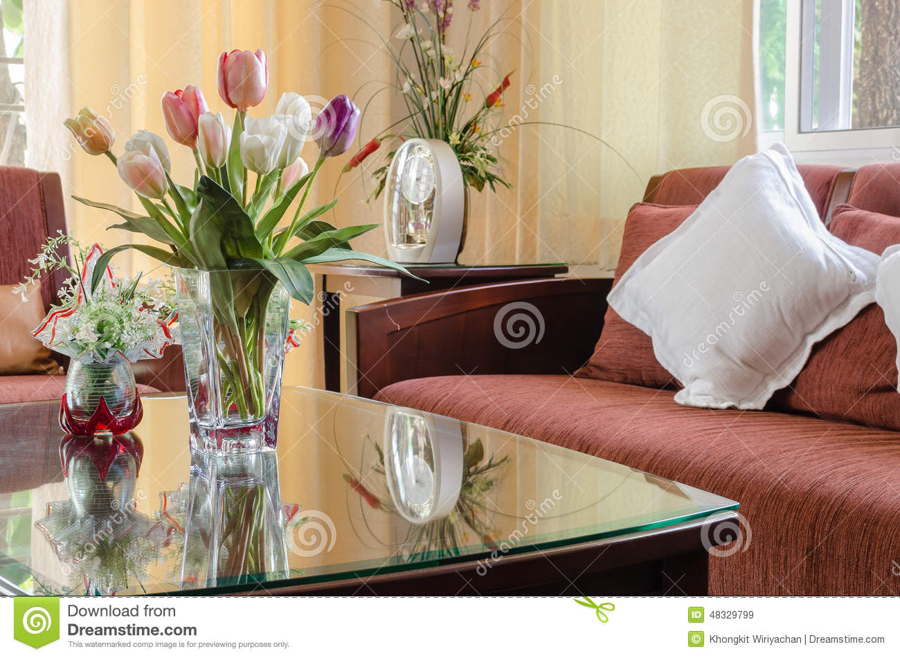 living room flowers built ins with red wooden sofa and vase of flower stock image