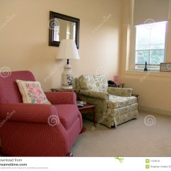 X Rocker Chairs Padded Card Table And Living Room Well Lit By Daylight Stock Image - Image: 1124619