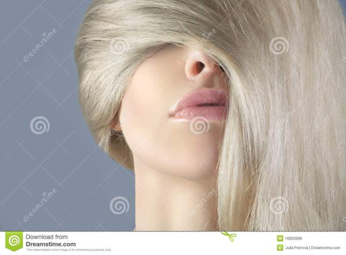 long hair blonde in the face of a woman. stock photo - image