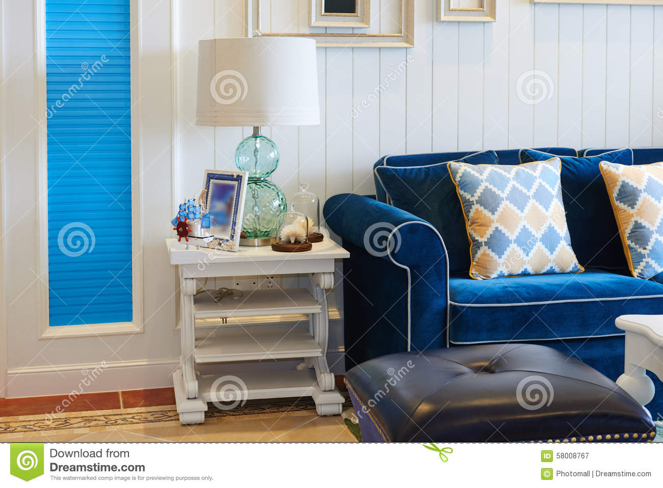 Luxury Living Room With Blue Sofa Glass Table Light At Home